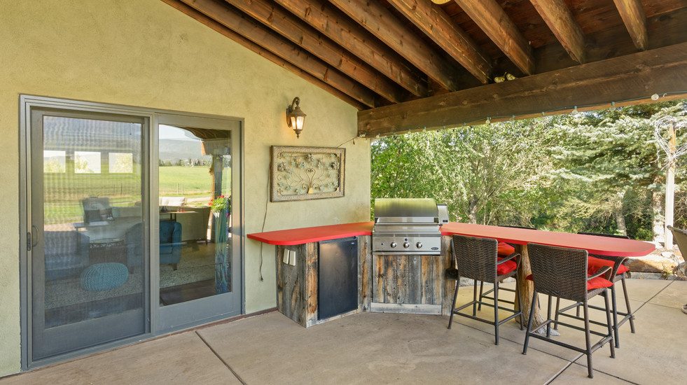 Built-in grill and eat-at bar on your spacious patio