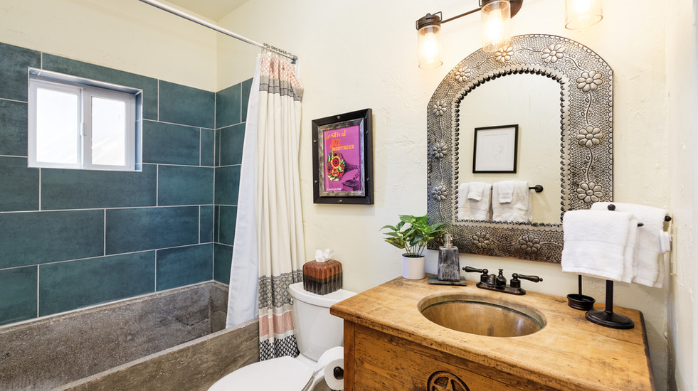 Newly-renovated bathroom with hand-poured concrete tub and southwestern vibes.