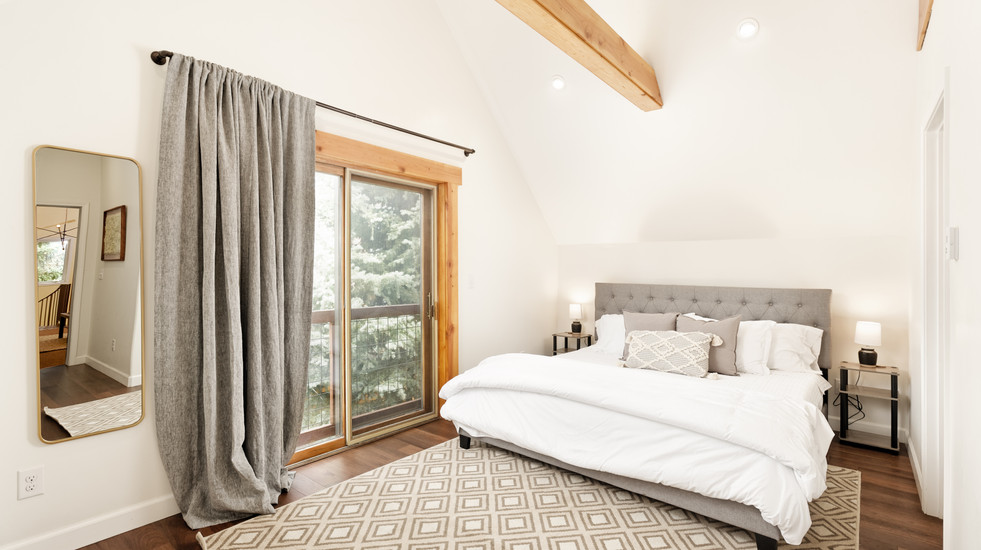 Your newly-built master suite addition with treetop views.