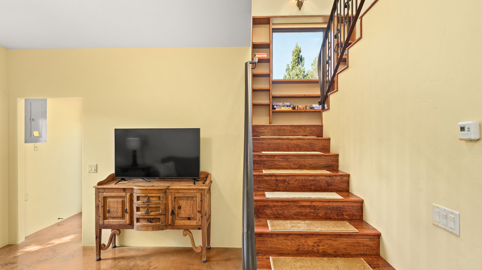 Travel downstairs to your second living space and guest bedrooms