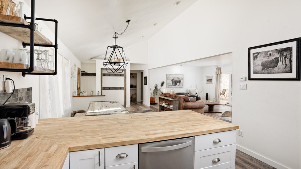 Spacious and open-concept kitchen, living, and dining area