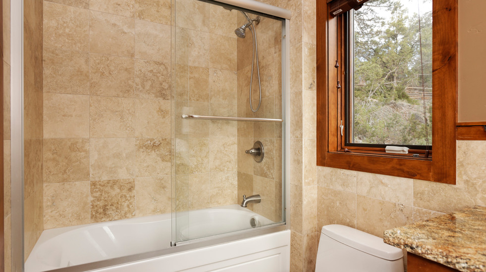 Detached guest bathroom with jet tub and shower.