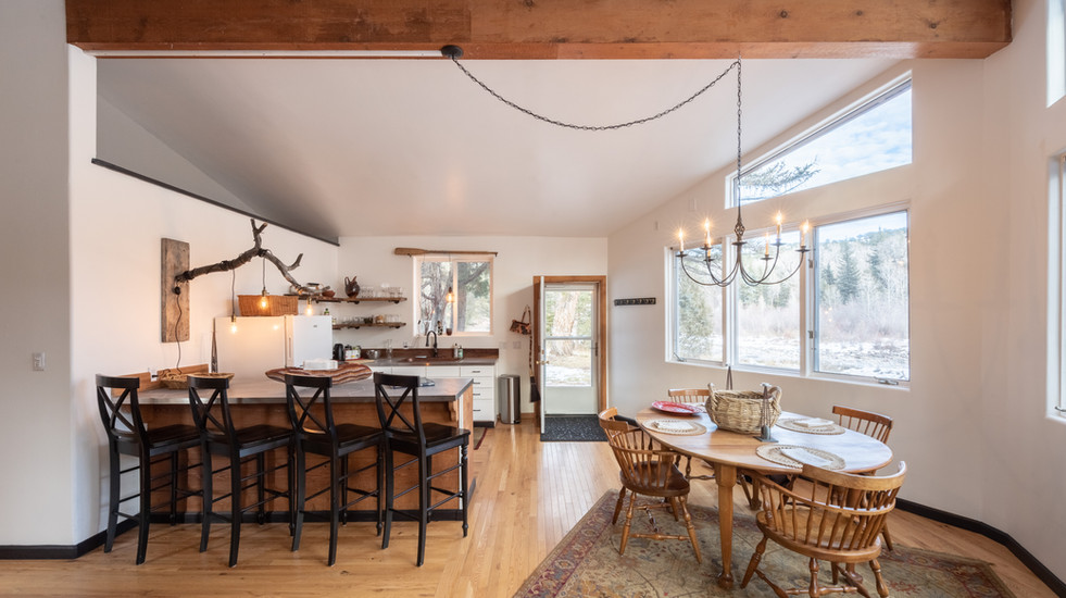 Spacious dining and kitchen area with expansive views of the river and mountain