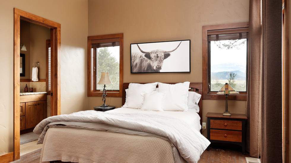 Comfortable master bedroom with views of the valley.
