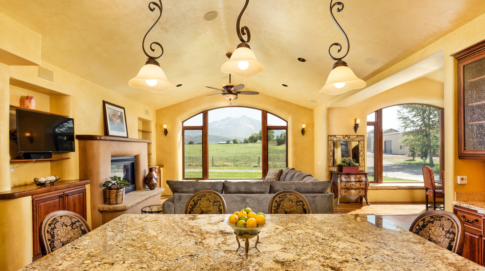 Looking out from your kitchen island to the living room and Mount Sopris beyond