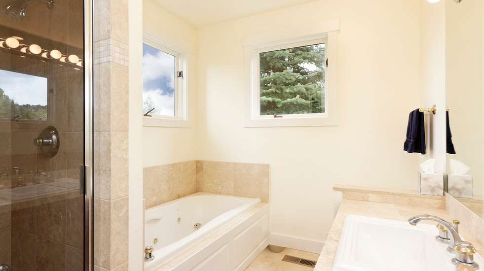 Main floor ensuite bathroom with separate tub and shower.