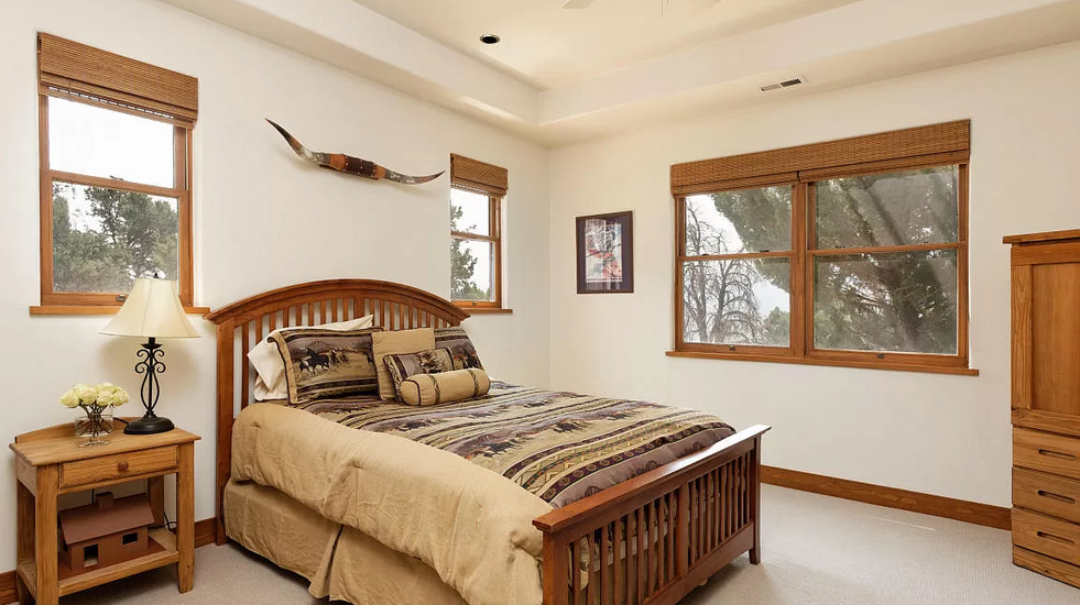 One of four guest rooms