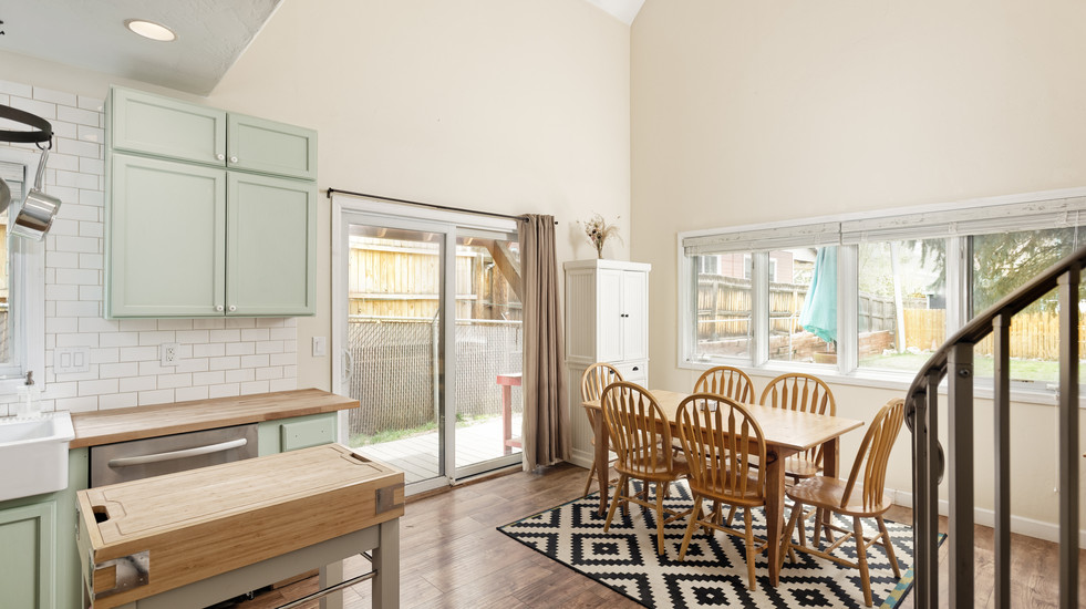Open-concept dining with large ceilings and lots of natural light!