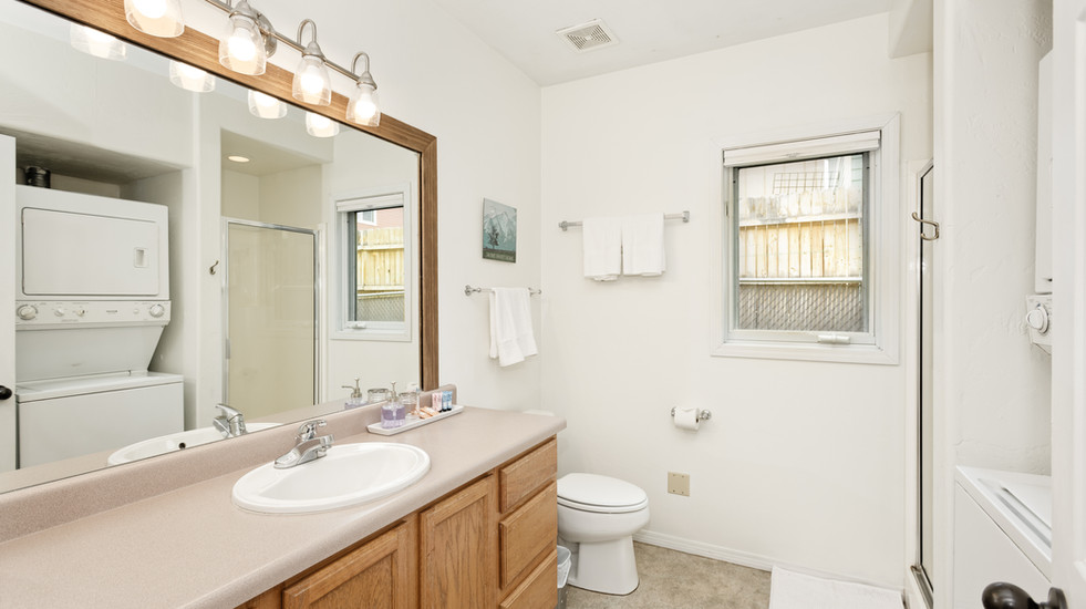 First floor ensuite guest bathroom with shower and W/D