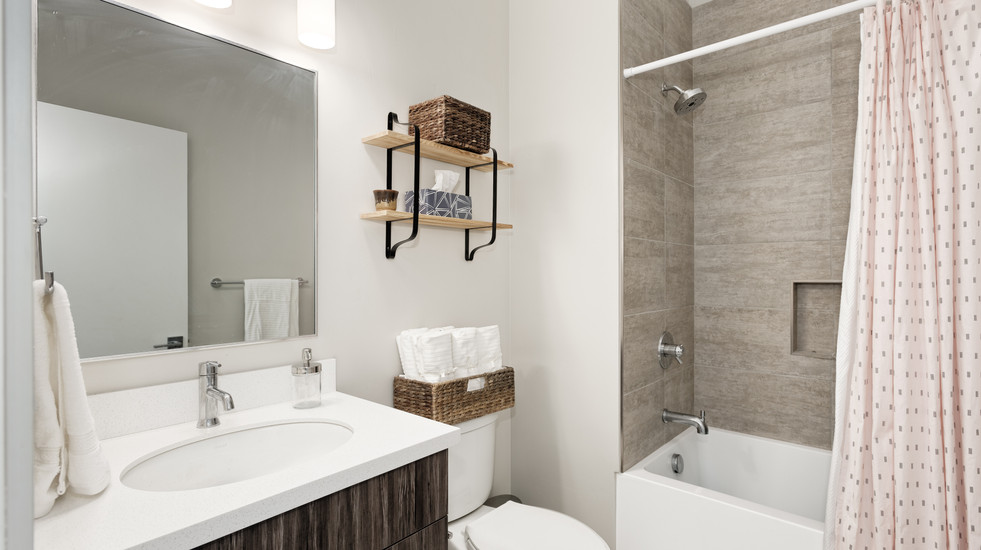 Shared upstairs bathroom with a combination tub/shower
