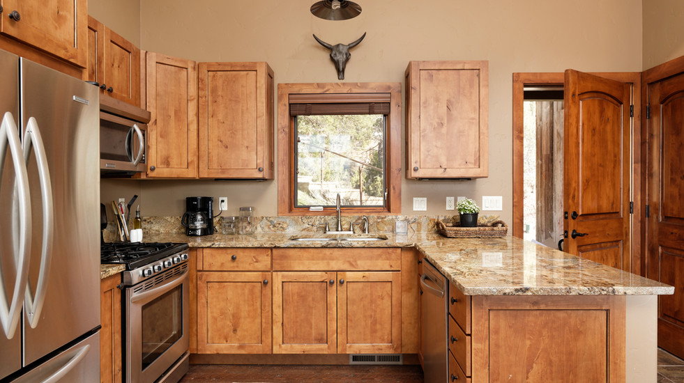 Well-appointed kitchen with gas range and full utensils and cookware.