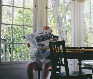 man reading paper.jpg