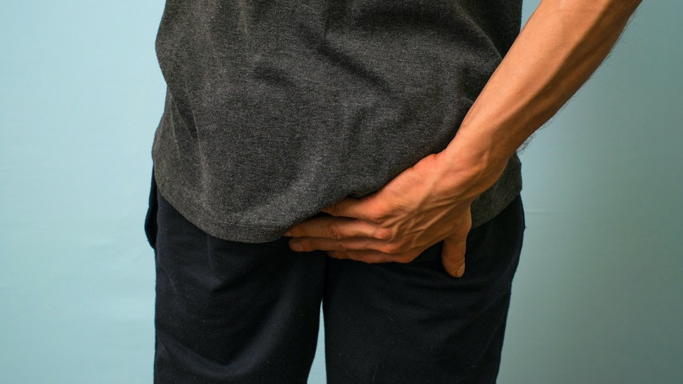 Man scratching his butt