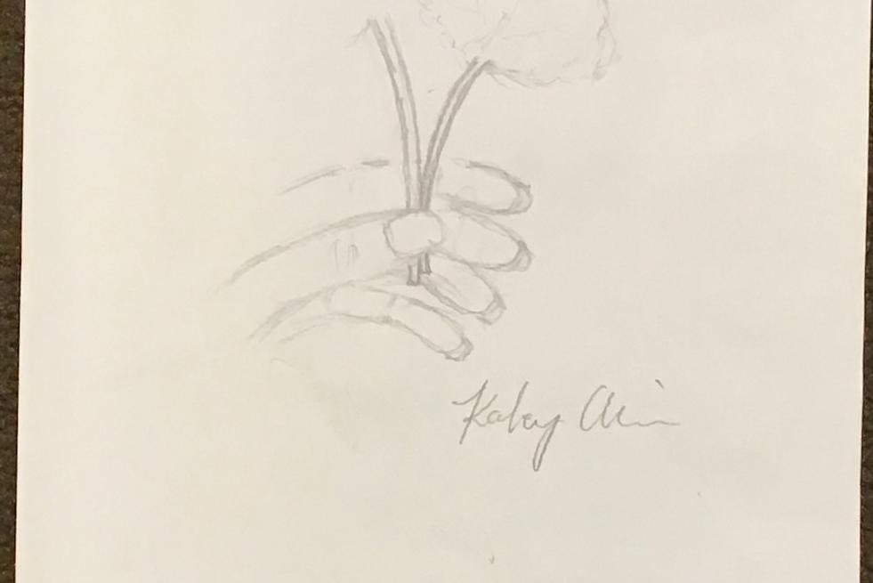 Kaley - Hand me a flower.HEIC