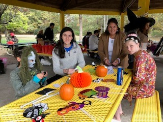 Volunteers and Participants decorating spooky masks