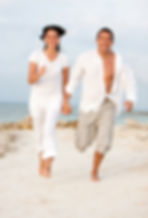 man woman running on beach 16137864.jpg