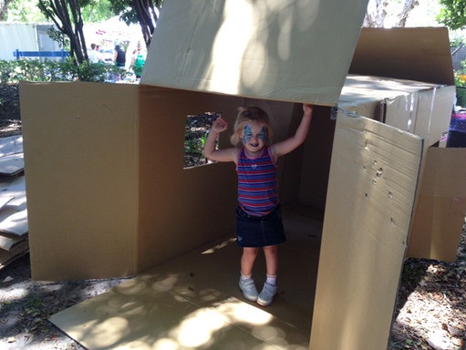 A little girl in cubby house