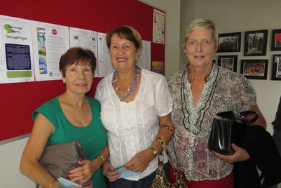 A group picture of three ladies at the centre