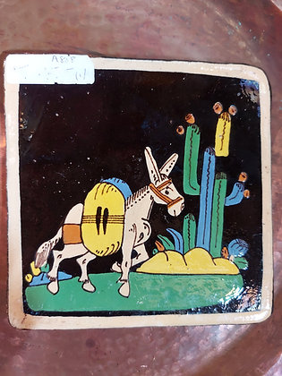 Mexican-tourist-pottery-tile-black-background-donkey