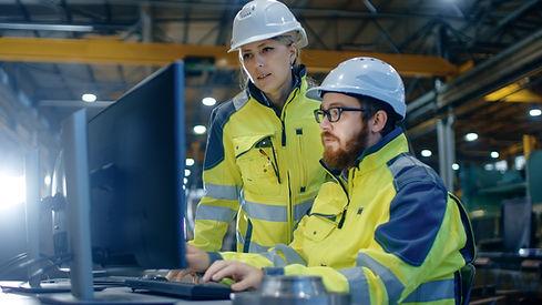 Male Industrial Engineer Works on the Pe