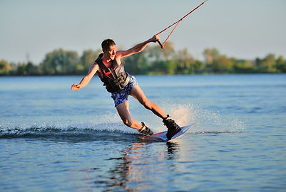 the guy is riding a wakeboard on the riv