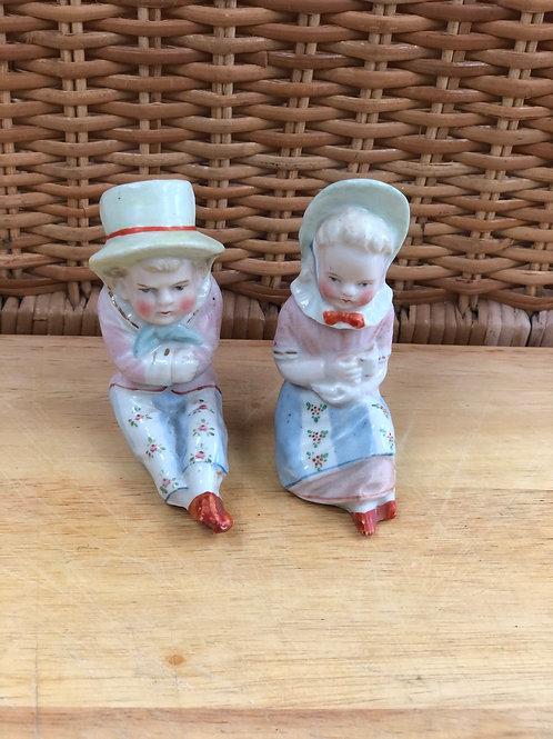 2 children fragile ornaments (L)