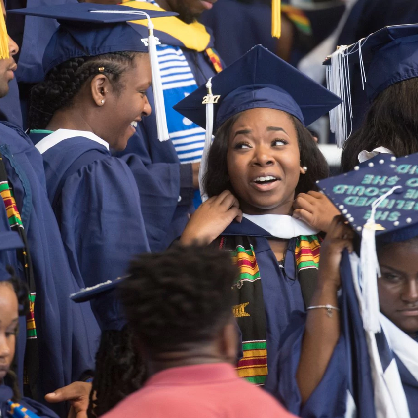 Angel C. Dye, center, was able to receive her undergraduate degree from Howard University thanks in part to the generosity of people who stepped in to help. (Marvin Joseph_The Washington Post)