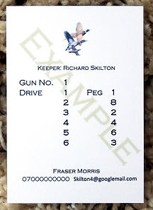Bespoke personalised shoot cards showing drive and peg numbers along with pheasant duck and partridge