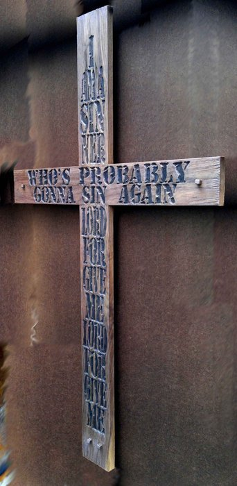 cross with carved-in letters