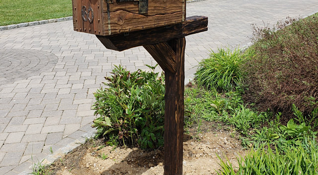 Rustic mailbox with the post in NY