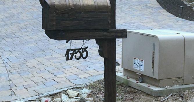 Rustic mailbox with the copper roof