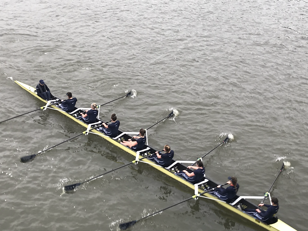 Oxford women's crew in a boat rowing