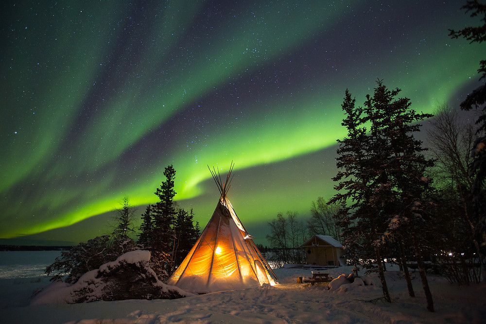 Image Name: When The Sky Lights Up  Photographer Name: Nicky Loh  Year: 2018  Image Description: <p>A traditional native tepee lights up at B Dene in Yellowknife during an aurora showing on New Years Day January 1, 2017.