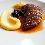 Duck roasted with lavender honey, sweet corn and blueberries