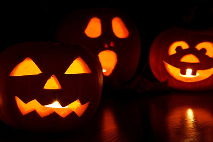 Canva - Three Lit Jack-o'-lanterns.jpg