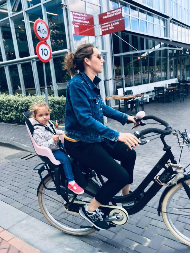 mother bikes cycling in amsterdam