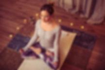 Women meditating on a yoga mat