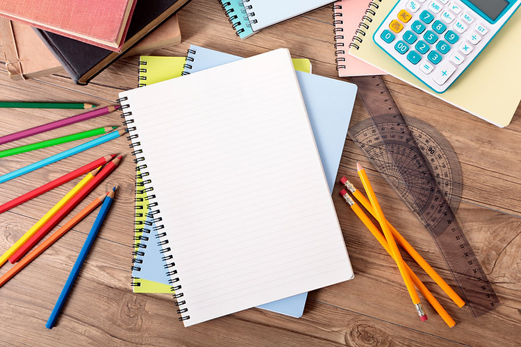 Picture of colored pencils, a note book and measuring tools.