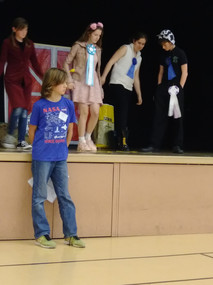 A group presenting their Share the Fun skit at Area Presentation Day.