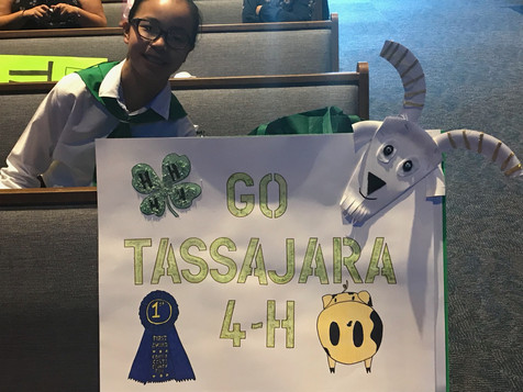 A Tassajara 4-H member showing off her awesome sign at Achievement Night