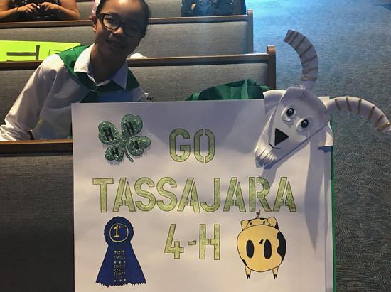 A Tassajara Member posing with an awesome Tassajara sign at Achievement Night.