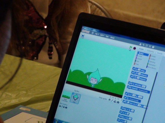 A 4-H member trying their hand at coding her own character using Scratch.