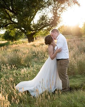 kissing at sunset wedding photographer.j