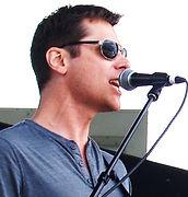 Joel singing at microphone.jpg