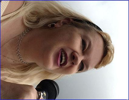 Patti -- singing with microphone.jpg