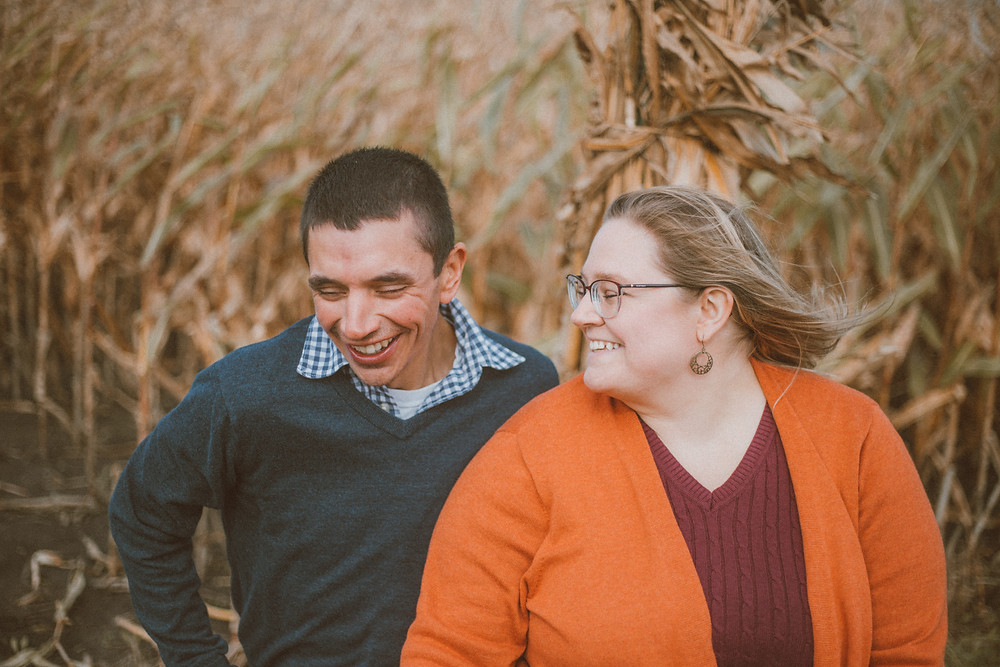 Couple shares a laugh together. Lifestyle couples photography by Anna Gutermuth.
