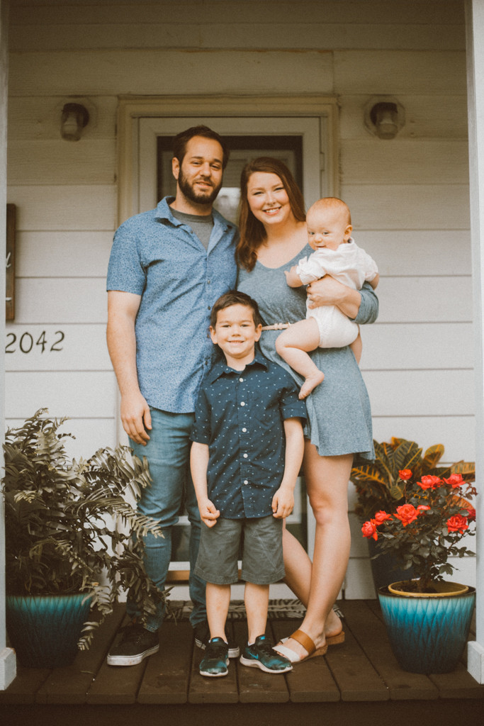 Family posing on the front porch of their new house. Lifestyle family photography in Trevor, WI.