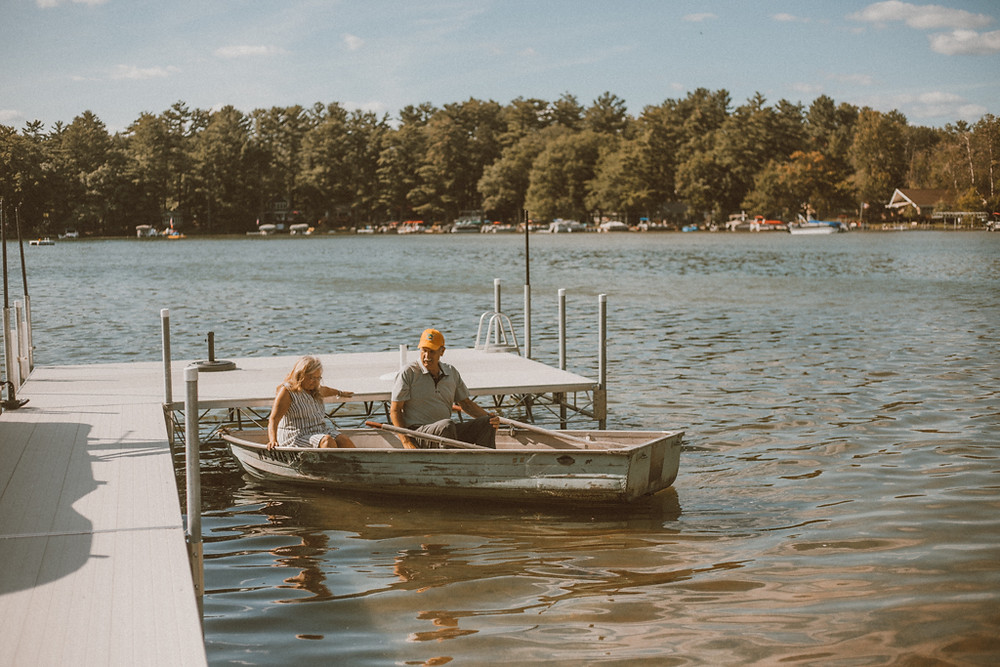 Couple in a row boat on the lake. Lifestyle Photography by Anna Gutermuth.
