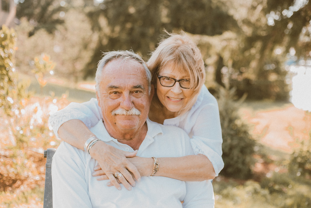 Wife hugs her husband. Lifestyle Photography by Anna Gutermuth.