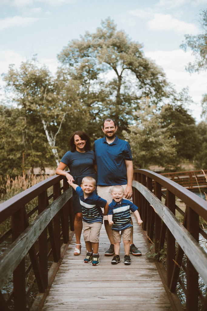 Family standing on the bridge. Lifestyle family photography by Anna Gutermuth.